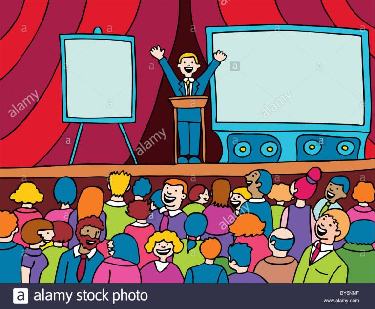 public-speaker-presenting-to-a-large-group-of-people-on-a-stage-by6nnf